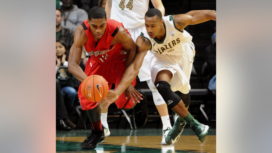 Northeastern's Quincy Ford, left, and UAB's Robert Williams chase a loose ball during the first half of an NCAA college basketball game at Bartow Arena in Birmingham, Ala., Saturday, Dec. 29, 2012. UAB won 83-63. (AP Photo/ AL.com, Mark Almond)  MAGAZINES OUT