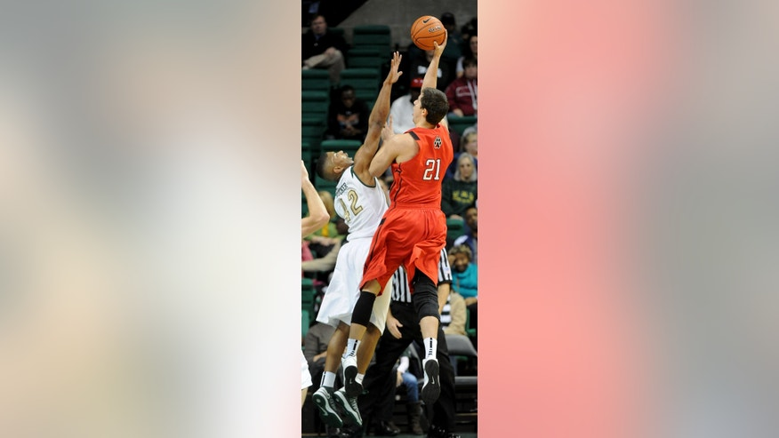 Northeastern's Dinko Marshavelski (21) shoots over UAB's Rod Rucker during the first half of an NCAA college basketball game at Bartow Arena in Birmingham, Ala., Saturday, Dec. 29, 2012. UAB won 83-63. (AP Photo/ AL.com, Mark Almond)  MAGAZINES OUT