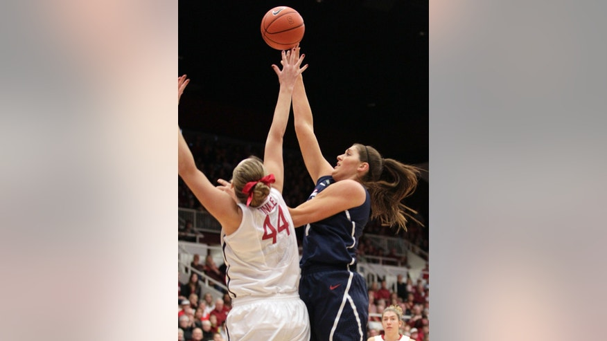 Connecticut center Stefanie Dolson, right, pulls up for a shot over Stanford forward Joslyn Tinkle (44) during the first half of an NCAA college basketball game in Stanford, Calif., Saturday, Dec. 29, 2012. (AP Photo/Tony Avelar)