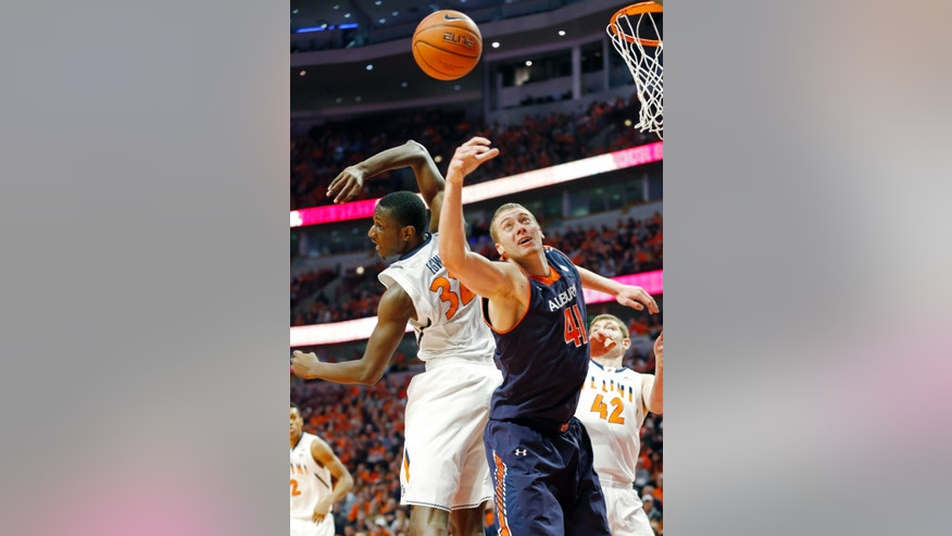 Auburn center Rob Chubb, right, battles for a rebound with Illinois forward Nnanna Egwu during the first half of an NCAA college basketball game in Chicago, Saturday, Dec. 29, 2012. (AP Photo/Nam Y. Huh)
