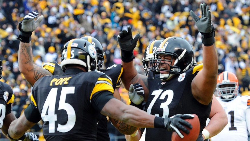 Pittsburgh Steelers tight end Leonard Pope (45) celebrates with guard Ramon Foster (73) after making a touchdown catch in the second quarter of an NFL football game against the Cleveland Browns, Sunday, Dec. 30, 2012, in Pittsburgh. (AP Photo/Don Wright)
