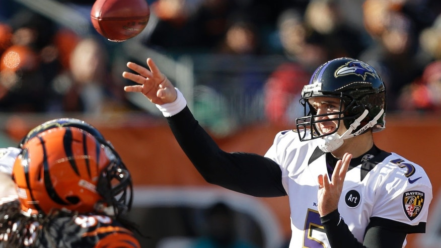 Baltimore Ravens quarterback Joe Flacco (5) passes against the Cincinnati Bengals in the first half of an NFL football game on Sunday, Dec. 30, 2012, in Cincinnati. (AP Photo/Al Behrman)