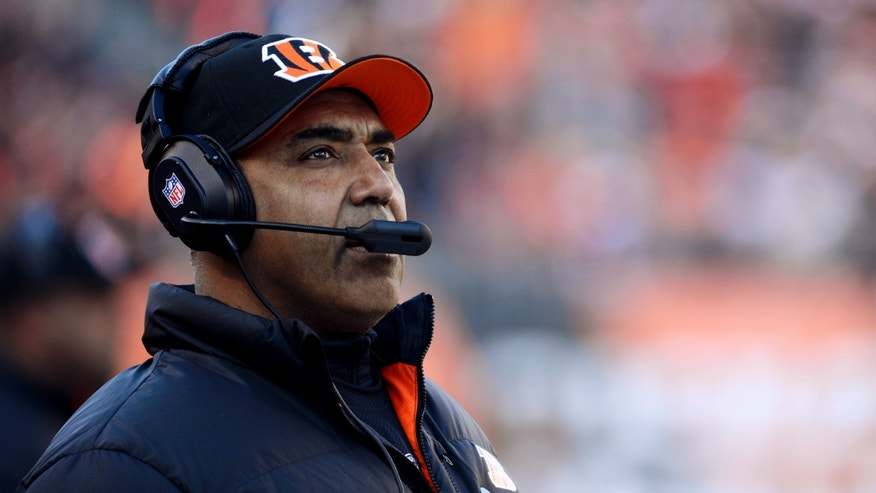 Cincinnati Bengals head coach Marvin Lewis watches from the sidelines in the first half of an NFL football game against the Baltimore Ravens, Sunday, Dec. 30, 2012, in Cincinnati. (AP Photo/Michael Keating)