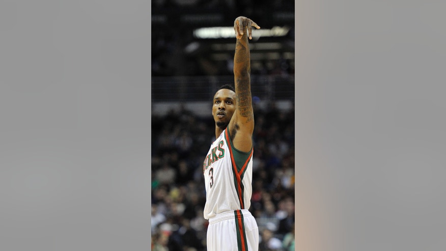 Milwaukee Bucks' Brandon Jennings (3) reacts after sinking a three-point basket against the Miami Heat during the second half of an NBA basketball game on Saturday, Dec. 29, 2012, in Milwaukee. (AP Photo/Jim Prisching)