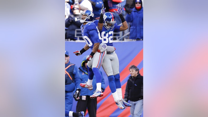 New York Giants wide receiver Rueben Randle (82) celebrates with teammate Victor Cruz (80) after scoring a touchdown during the first half of an NFL football game against the Philadelphia Eagles, Sunday, Dec. 30, 2012 in East Rutherford, N.J. (AP Photo/Kathy Willens)