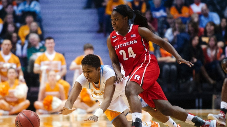 Tennessee's Kamiko Williams and Rutgers' Shakena Richardson chase after a loose ball during their NCAA college basketball game in Knoxville, Tenn., Sunday, Dec. 30, 2012. (AP Photo/The Knoxville News Sentinel, Saul Young)