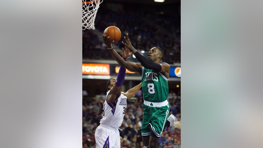 Boston Celtics forward Jeff Green (8) drives to the basket against Sacramento Kings defender Jason Thompson during the first half of an NBA basketball game in Sacramento, Calif., on Sunday, Dec. 30, 2012.(AP Photo/Steve Yeater)