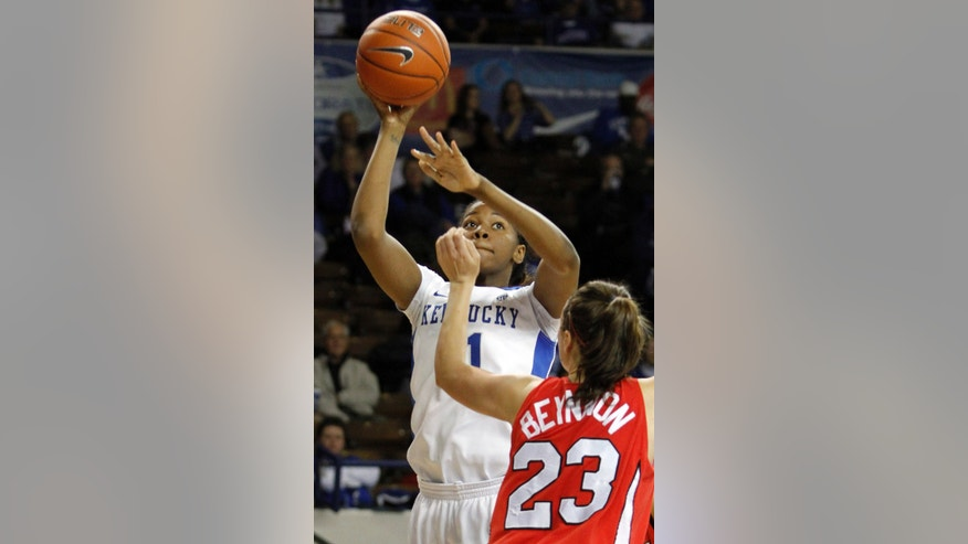 Kentucky's DeNesha Stallworth, left, shoots over Marist's Elizabeth Beynnon during the first half of an NCAA women's college basketball game at Memorial Coliseum in Lexington, Ky., Sunday, Dec. 30, 2012. (AP Photo/James Crisp)
