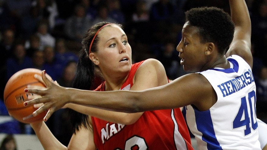 Marist's Kristina Danella (33) is pressured by Brittany Henderson (40) during the first half of an NCAA women's college basketball game at Memorial Coliseum in Lexington, Ky., Sunday, Dec. 30, 2012. (AP Photo/James Crisp)