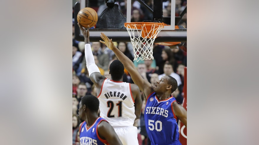 Philadelphia 76ers center Lavoy Allen, right, defends as Portland Trail Blazers center J.J. Hickson shoots during the first quarter of an NBA basketball game in Portland, Ore., Saturday, Dec. 29, 2012.(AP Photo/Don Ryan)