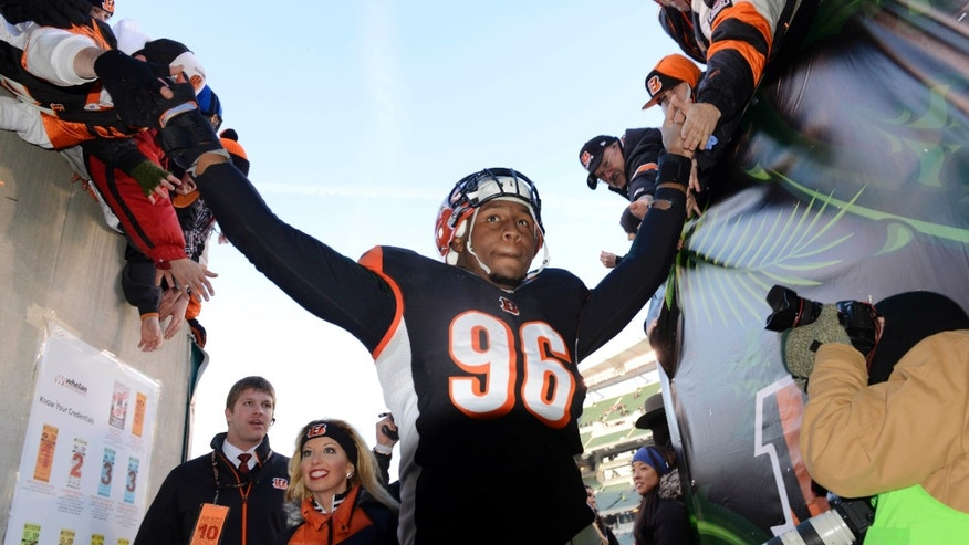 Cincinnati Bengals defensive end Carlos Dunlap leaves the field after their 23-17 win against the Baltimore Ravens in an NFL football game, Sunday, Dec. 30, 2012, in Cincinnati. (AP Photo/Michael Keating)