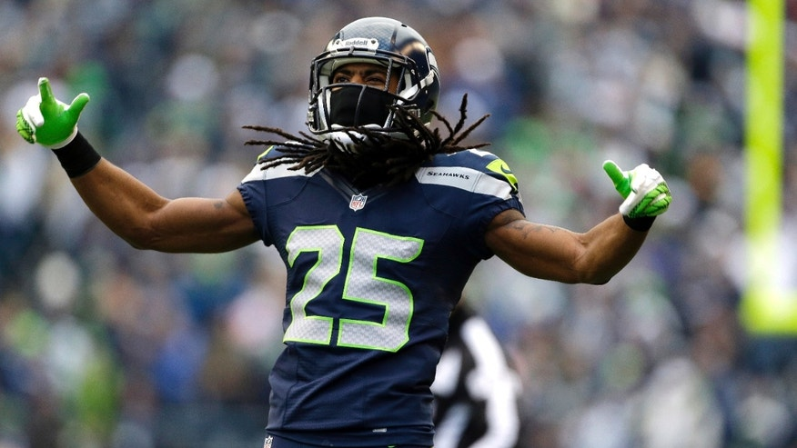 Seattle Seahawks' Richard Sherman reacts to a play against the St. Louis Rams in the first half of an NFL football game, Sunday, Dec. 30, 2012, in Seattle. (AP Photo/Elaine Thompson)