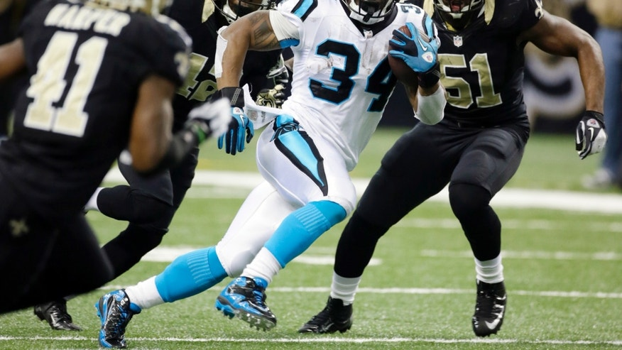 Carolina Panthers' DeAngelo Williams (34) breaks away for a 65-heard run during the first half of an NFL football game against the New Orleans Saints Sunday, Dec. 30, 2012, in New Orleans. (AP Photo/Dave Martin)