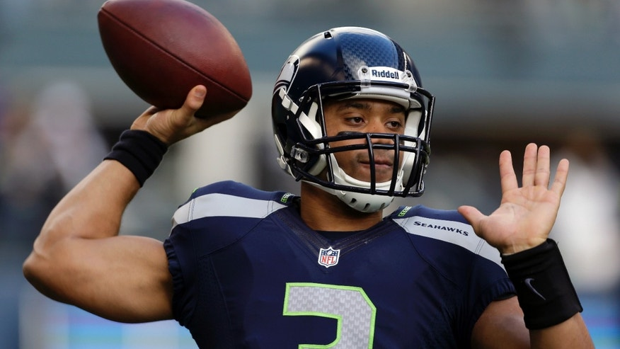 Seattle Seahawks quarterback Russell Wilson passes during warm-ups before an NFL football game against the St. Louis Rams, Sunday, Dec. 30, 2012, in Seattle. (AP Photo/Elaine Thompson)