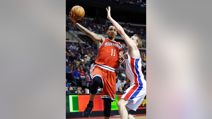 Milwaukee Bucks guard Monta Ellis (11) goes to the basket against Detroit Pistons forward Kyle Singler in the first half of an NBA basketball game, Sunday, Dec. 30, 2012, in Auburn Hills, Mich. (AP Photo/Duane Burleson)