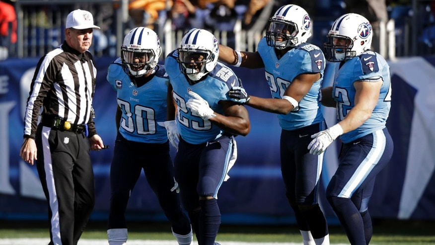 Tennessee Titans running back Darius Reynaud (25) celebrates with Jason McCourty (30), Alterraun Verner (20) and Collin Mooney (42) after scoring a touchdown on an 81-yard punt return against the Jacksonville Jaguars in the third quarter of an NFL football game, Sunday, Dec. 30, 2012, in Nashville, Tenn. (AP Photo/Wade Payne)