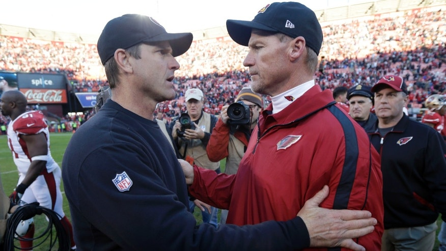 San Francisco 49ers head coach Jim Harbaugh, left, hugs Arizona Cardinals head coach Ken Whisenhunt at the end of an NFL football game in San Francisco, Sunday, Dec. 30, 2012. San Francisco won won 27-13. (AP Photo/Marcio Jose Sanchez)