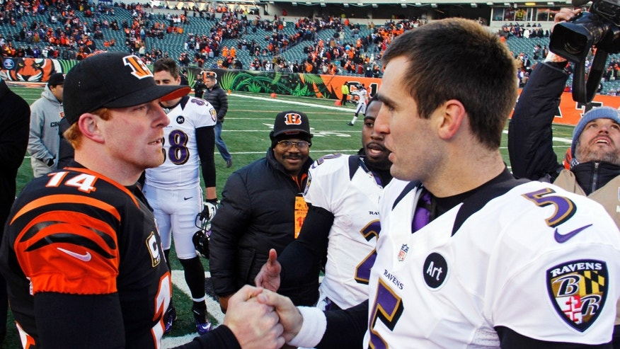 Cincinnati Bengals quarterback Andy Dalton (14) greets Baltimore Ravens quarterback Joe Flacco (5) after the Bengals' 23-17 win in an NFL football game, Sunday, Dec. 30, 2012, in Cincinnati. (AP Photo/Tom Uhlman)