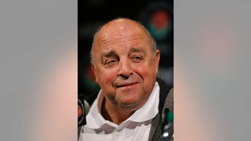 Wisconsin athletic director Barry Alvarez talks to reporters during the Rose Bowl media day in Los Angeles, Saturday, Dec. 29, 2012. Wisconsin will face Stanford in the Rose Bowl NCAA college football game on New Year's Day in Pasadena, Calif. (AP Photo/Jae Hong)