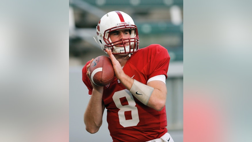 Stanford quarterback Kevin Hogan looks to pass during practice in Carson, Calif., Saturday, Dec. 29, 2012. Stanford will face Wisconsin on New Year's Day in the Rose Bowl NCAA college football game in Pasadena, Calif. (AP Photo/Jae Hong)