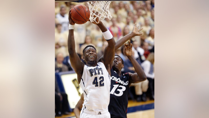 Pittsburgh's Talib Zanna (42) shoots in front of Cincinnati's Cheikh Mbodj (13) in the first half of the NCAA college basketball game, Monday, Dec. 31, 2012, in Pittsburgh. (AP Photo/Keith Srakocic)