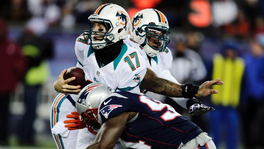 New England Patriots defensive end Justin Francis (94) sacks Miami Dolphins quarterback Ryan Tannehill (17) during the first quarter of an NFL football game in Foxborough, Mass., Sunday, Dec. 30, 2012. (AP Photo/Charles Krupa)