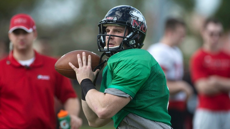 Northern Illinois quarterback Jordan Lynch throws a pass during NCAA college football practice, Wednesday, Dec. 26, 2012, in Miami, for the Orange Bowl. Northern Illinois faces Florida State on New Year's Day. (AP Photo/J Pat Carter)