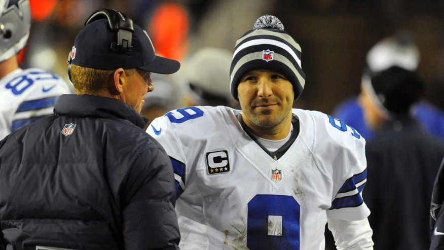 Dallas Cowboys head coach Jason Garrett talks with quarterback Tony Romo (9) during the second half of an NFL football game against the Washington Redskins Sunday, Dec. 30, 2012, in Landover, Md. (AP Photo/Richard Lipski)