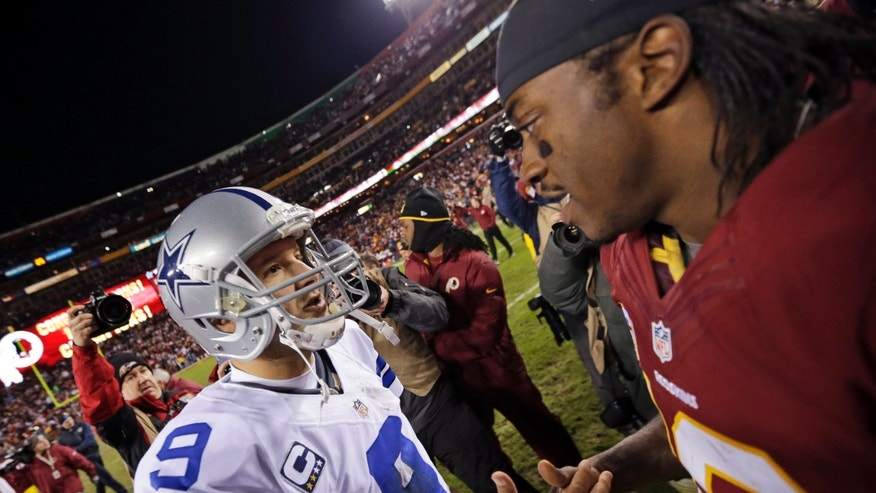 Dallas Cowboys quarterback Tony Romo (9) greets Washington Redskins quarterback Robert Griffin III after an NFL football game Sunday, Dec. 30, 2012, in Landover, Md. The Redskins won 28-18, securing a playoff berth. (AP Photo/Evan Vucci)