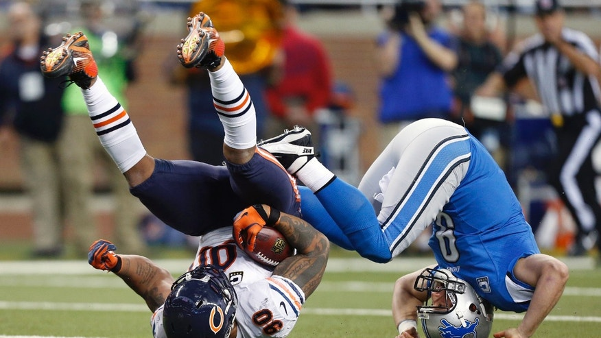 Chicago Bears defensive end Julius Peppers (90) recovers a loose ball and is stopped by Detroit Lions quarterback Matthew Stafford (9) during the second quarter of an NFL football game at Ford Field in Detroit, Sunday, Dec. 30, 2012. (AP Photo/Rick Osentoski)