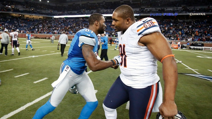 Detroit Lions wide receiver Calvin Johnson, left, and Chicago Bears defensive tackle Amobi Okoye (91) greet each other after their NFL football game at Ford Field in Detroit, Sunday, Dec. 30, 2012. (AP Photo/Duane Burleson)