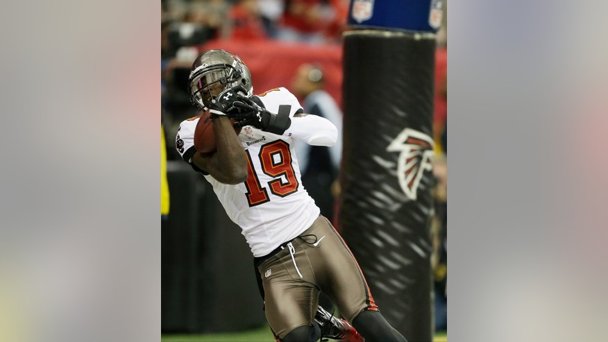 Tampa Bay Buccaneers wide receiver Mike Williams (19) makes a touch-down catch during the first half of an NFL football game against the Atlanta Falcons, Sunday, Dec. 30, 2012, in Atlanta. (AP Photo/David Goldman)