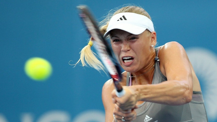 Caroline Wozniacki, of Denmark, plays a return shot during her first round match against Ksenia Pervak, of Kazakhstan, during the Brisbane International tennis tournament in Brisbane, Australia, Monday, Dec. 31, 2012.  (AP Photo/Tertius Pickard)