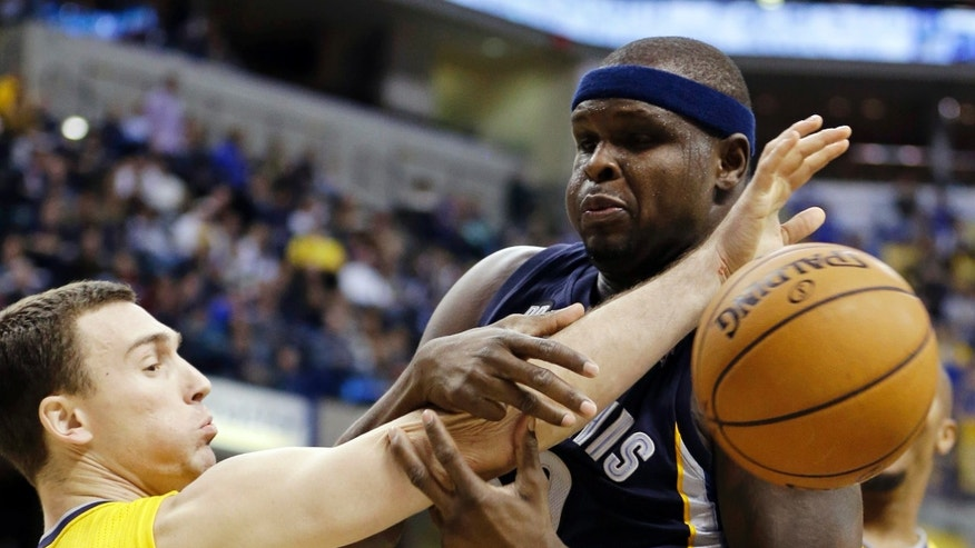 Indiana Pacers' Ben Hansbrough (23) and Memphis Grizzlies' Zach Randolph (50) battle for a rebound during the second half of an NBA basketball game, Monday, Dec. 31, 2012, in Indianapolis. Indiana won 88-83. (AP Photo/Darron Cummings)