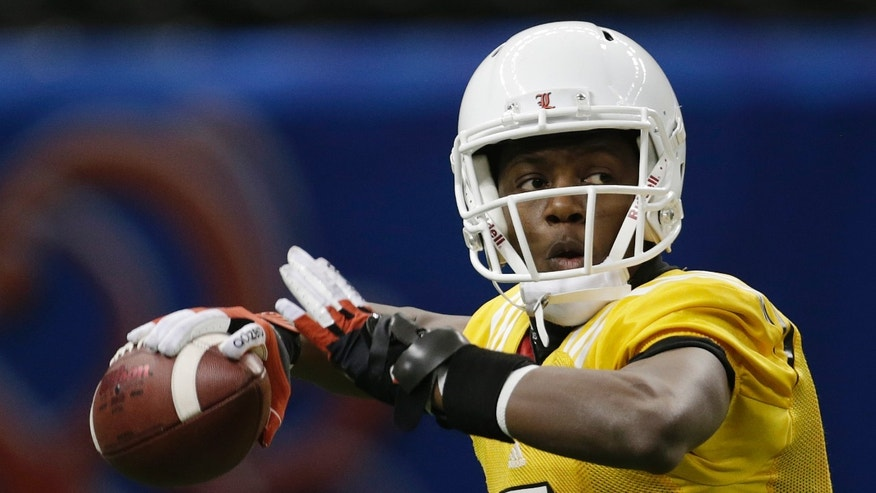 Louisville quarterback Teddy Bridgewater (5) throws during practice at the Superdome in New Orleans Monday, Dec. 31, 2012. Louisville will face Florida in the Sugar Bowl, an NCAA college football game, on Jan. 2nd. (AP Photo/Dave Martin)