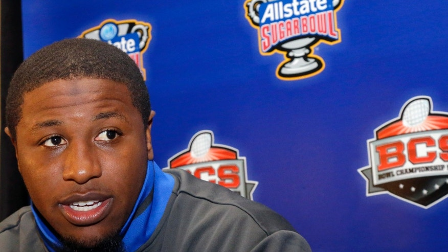 Florida linebacker Jon Bostic  answers questions at a news conference in New Orleans, Saturday, Dec. 29, 2012. Florida will face Louisville in the  Sugar Bowl NCAA college football game on Jan. 2, 2013. (AP Photo/Bill Haber)