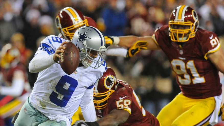 Dallas Cowboys quarterback Tony Romo (9) is sacked by Washington Redskins inside linebacker London Fletcher (59) during the second half of an NFL football game Sunday, Dec. 30, 2012, in Landover, Md. The Redskins won 28-18, securing a playoff berth. (AP Photo/Richard Lipski)