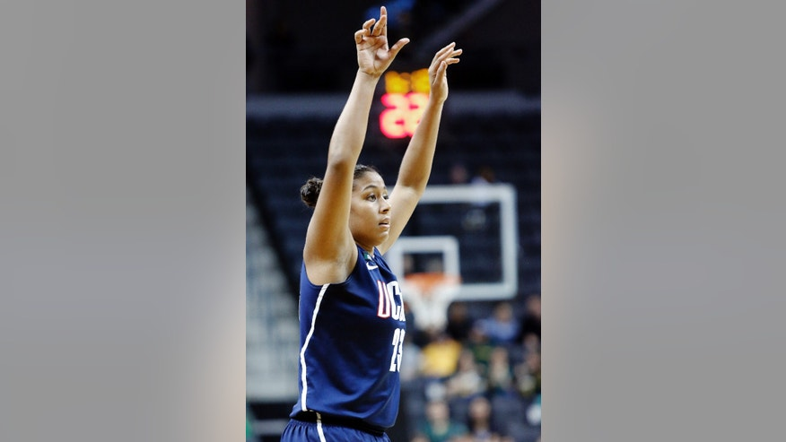 Connecticut forward Kaleena Mosqueda-Lewis watches her 3-pointer during the second half of an NCAA college basketball game against Oregon in Eugene, Ore., Monday, Dec. 31, 2012. Mosqueda-Lewis scored 19 points as Connecticut won 95-51. (AP Photo/Don Ryan)