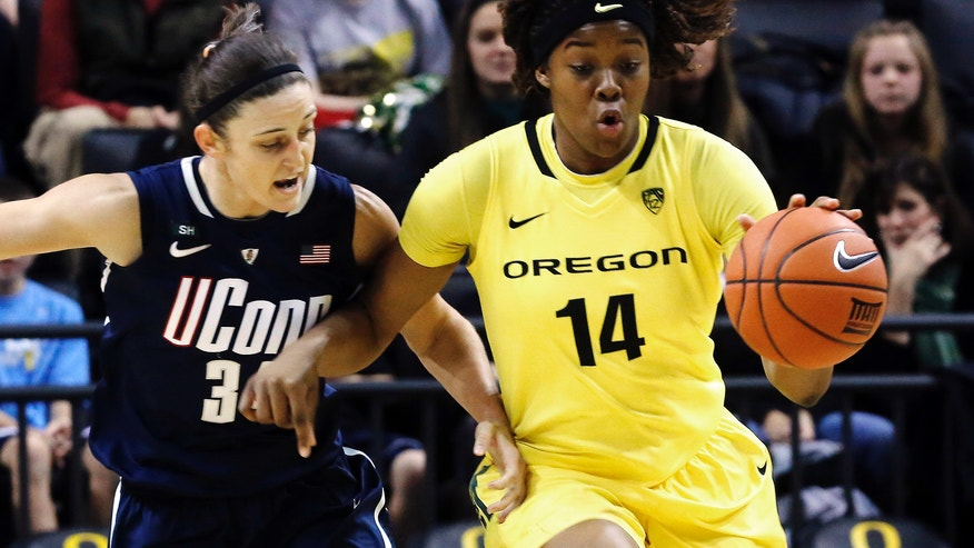 Oregon forward Jillian Alleyne, right, races downcourt as Connecticut guard Kelly Faris defends during the first half of an NCAA college basketball game in Eugene, Ore., Monday, Dec. 31, 2012.(AP Photo/Don Ryan)