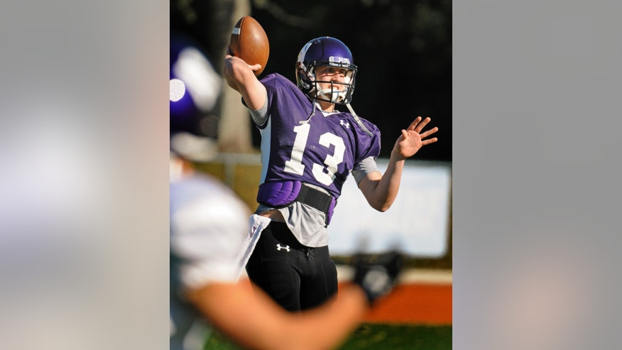 Northwestern quarterback Trevor Siemian throws a pass during NCAA college football practice, Thursday, Dec. 27, 2012, in Jacksonville, Fla.  The Wildcats take on the Mississippi State in the gator Bowl on New Year's Day.  (AP Photo/The Florida Times-Union, Bob Self)