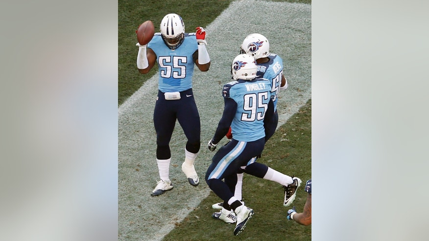 Tennessee Titans linebacker Zach Brown (55) celebrates with Kamerion Wimbley (95) and Akeem Ayers (56) after intercepting a pass and returning it 30 yards for a touchdown against the Jacksonville Jaguars in the third quarter of an NFL football game, Sunday, Dec. 30, 2012, in Nashville, Tenn. (AP Photo/Joe Howell)