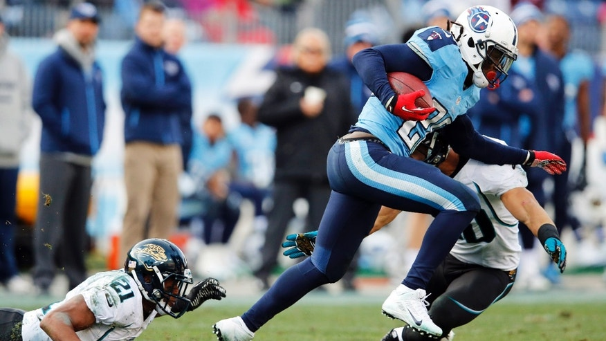 Tennessee Titans running back Chris Johnson (28) rushes past Jacksonville Jaguars' Derek Cox (21) and Russell Allen (50) in the fourth quarter of an NFL football game, Sunday, Dec. 30, 2012, in Nashville, Tenn. (AP Photo/Joe Howell)