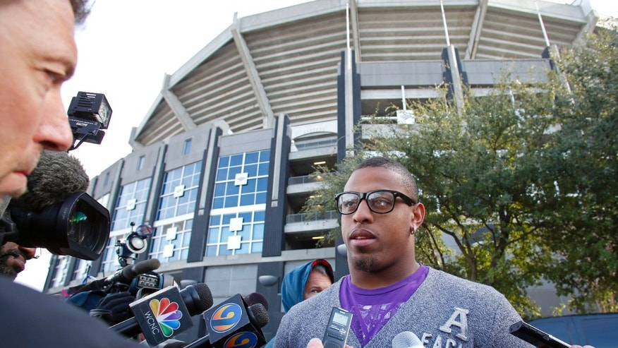 Carolina Panthers defensive end, Greg Hardy faces reporter's microphones, tape recorders and questions as he joins teammates in clearing out the locker room for the final time this season in Charlotte, N.C., Monday, Dec. 31, 2012.  (AP Photo/Bob Leverone)