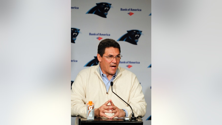 Carolina Panthers' head coach Ron Rivera describes how his team improved over the season at a brief news conference following the final team meeting of the season in Charlotte, N.C., Monday, Dec. 31, 2012. If Rivera does not return as Carolina's coach after a second straight losing season, he can at least take pride in the fact this his players never quit on him, even rallying from 11-points down, on the road, in a low-stakes season finale, to beat the Saints 44-38 on Sunday.  (AP Photo/Bob Leverone)