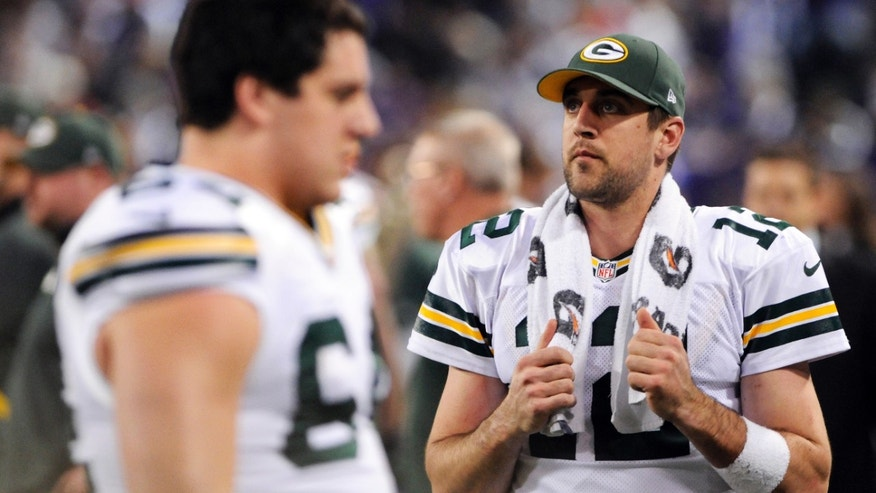Green Bay Packers quarterback Aaron Rodgers, right, watches from the sideline during the second half of an NFL football game against the Minnesota Vikings, Sunday, Dec. 30, 2012, in Minneapolis. The Vikings won 37-34. (AP Photo/Jim Mone)