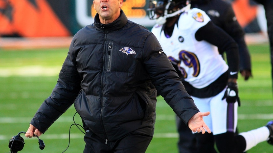 Baltimore Ravens head coach John Harbaugh reacts to a play in the second half of an NFL football game against the Cincinnati Bengals, Sunday, Dec. 30, 2012, in Cincinnati. (AP Photo/Tom Uhlman)
