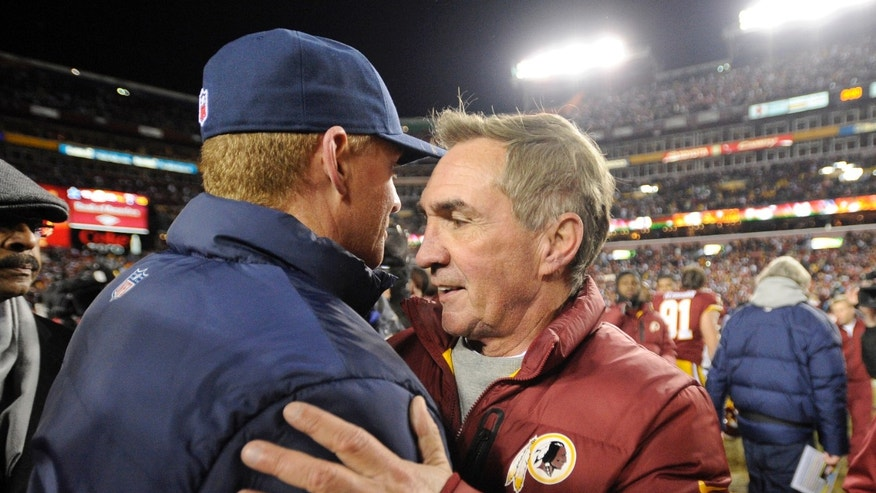 Dallas Cowboys coach Jason Garrett, left, greets Washington Redskins coach Mike Shanahan after an NFL football game Sunday, Dec. 30, 2012, in Landover, Md. The Redskins won 28-18, securing a playoff berth. (AP Photo/Nick Wass)