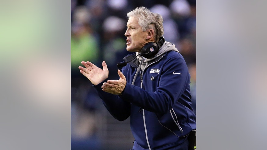 Seattle Seahawks head coach Pete Carroll cheers on his team late in their NFL football game against the St. Louis Rams, Sunday, Dec. 30, 2012, in Seattle. The Seahawks won 20-13. (AP Photo/Elaine Thompson)