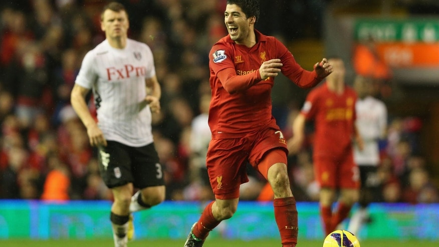 Luis Suarez of Liverpool reacts during the Barclays Premier League match between Liverpool and Fulham at Anfield on December 22, 2012 in Liverpool, England.  (Photo by Clive Brunskill/Getty Images)