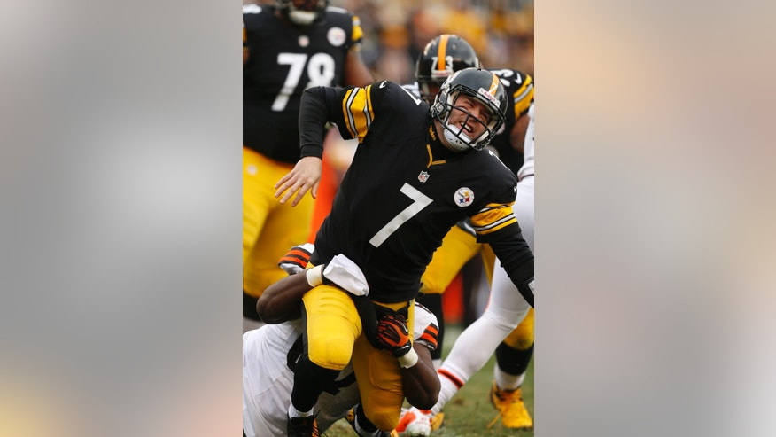 Pittsburgh Steelers quarterback Ben Roethlisberger (7) is hit from behind by Cleveland Browns nose tackle Ishmaa'ily Kitchen (67) after getting off a pass during the third quarter of an NFL football game in Pittsburgh, Sunday, Dec. 30, 2012. The Steelers won 24-10. (AP Photo/Gene J. Puskar)